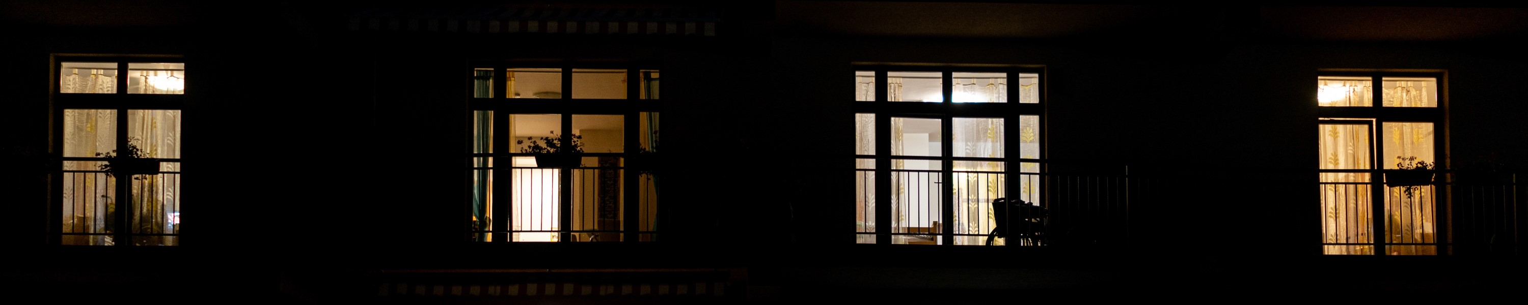 Illuminated building at night with people inside