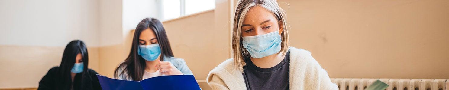 Students at desks with masks on