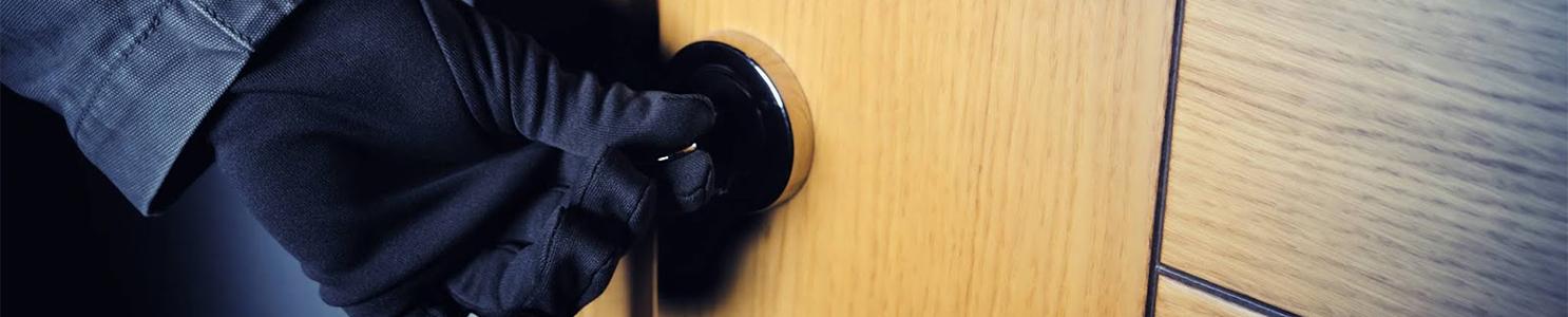 Gloved hand opening door [155153917]