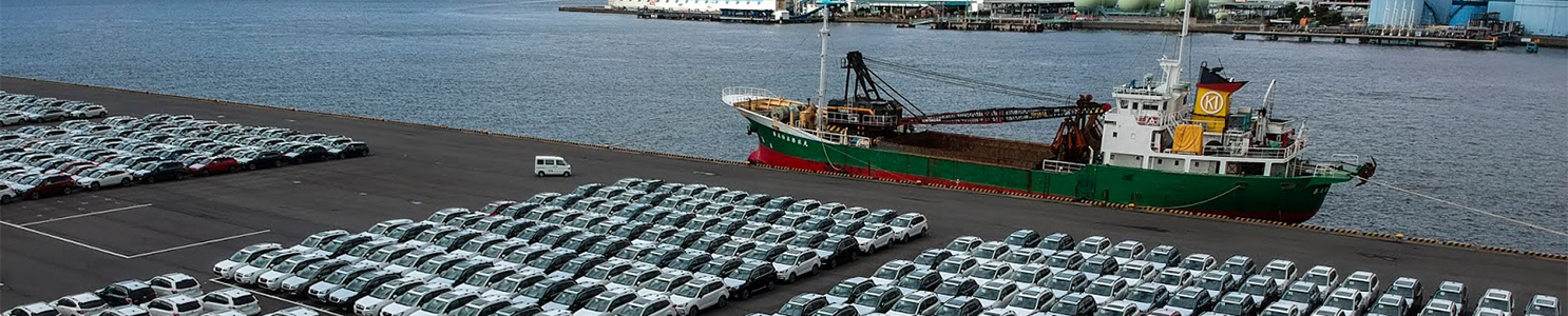 Lot of cars next to harbor [874289954]