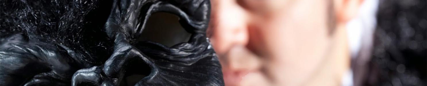 Man holding gorilla mask 101827362