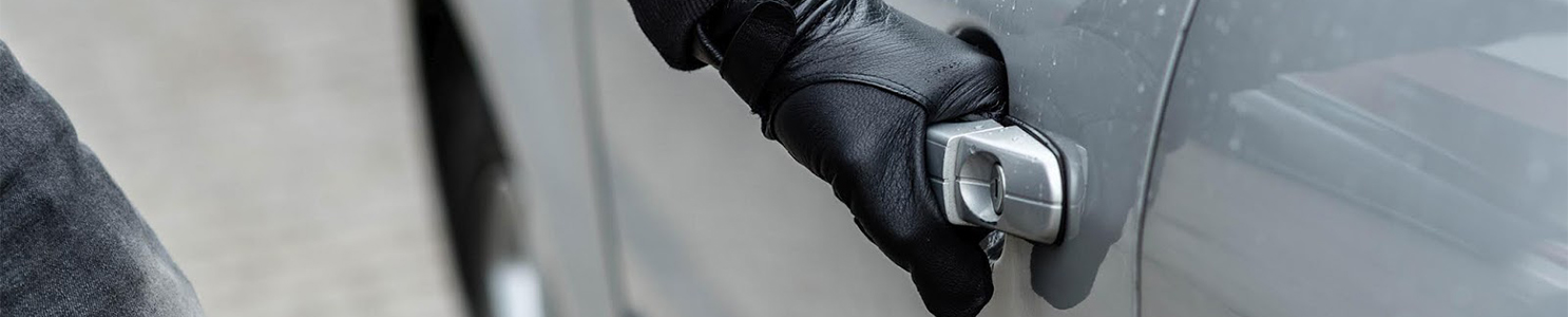 Thief Pulling Car Handle [521975360]